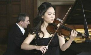Min-Jin Kym plays her antique Stradivarius violin. Photograph: National News and Pictures