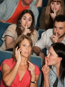 Audiences shush a woman taking a call at a concert (Shutterstock.com)