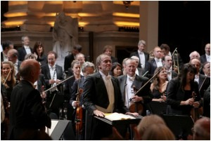 Valery Gergiev and members of the World Orchestra for Peace 2009 acknowledge the applause at the conclusion of the concert in the church of St Peter and St Paul, Krakow, marking the 70th anniversary of the start of WW2