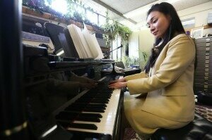 Yeaji Kim practices in the piano studio of professor Todd Welbourne. The South Korea-born Kim, who earned a doctorate in piano performance and pedagogy from UW-Madison this month, has created a new form of musical notation that she says will allow both visually impaired and sighted students to learn music side by side.