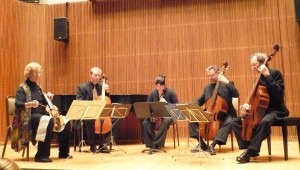 Smithsonian Consort of Viola, showing instruments supported by the players' legs