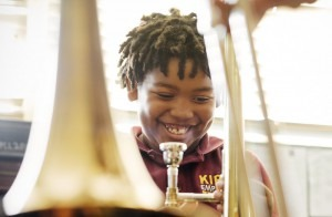 Amir Pinkney-Jengkens, 8, is learning trombone through Harmony Project, a nonprofit that provides musical instruments and instruction to children in low-income communities. Recent research suggests that such musical education may help improve kids' ability to process speech.Annie Tritt for NPR