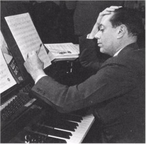Cole Porter, composing at the piano