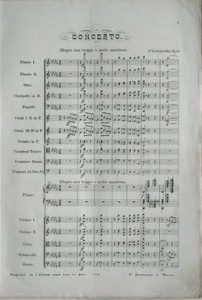 The first page of the Tchaikovsky's 1879 conducting score; the arpeggiated chords can be seen at the beginning of the piano part