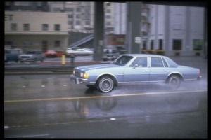 Image by Seattle Municipal Archives (Flickr: Car in rain, 1980s) [CC BY 2.0], via Wikimedia Commons