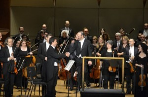 Concert master accepting conductor's thanks