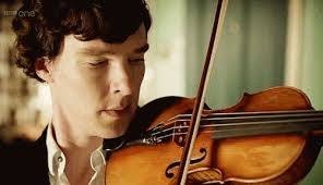 Benedict Cumberbatch as Sherlock with his violin