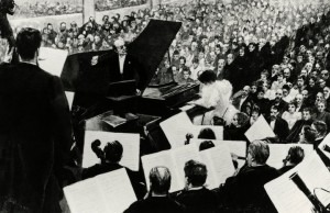 Hans von Bülow conducts Tchaikovsky's First Piano Concerto; lithograph by Hector Dumas, nineteenth centuryCredit: De Agostini Picture Library/Getty Images