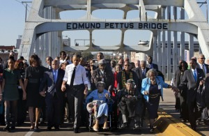 "President Obama leads a group walking hand-in-hand, with many singing ""We Shall Overcome,"" as they cross the Edmund Pettus Bridge on March 7, 2015, commemorating Bloody Sunday. Former president George W. Bush, just out of view to the right of this shot, and his wife Laura were also in the first row of the march.Credit: Jacquelyn Martin / AP"