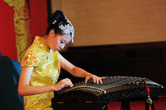 Girl playing a Zheng