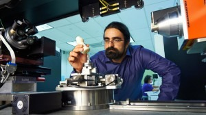Sina Shahbazmohamadi places a 3-D printed copy of a recorder foot joint into a measuring device in a lab at the University of Connecticut's Center for Clean Energy Engineering.Peter Morenus/UConn