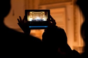 Distractions: Snapping a photograph with an iPad after a performance at Carnegie Hall.KARSTEN MORAN FOR THE NEW YORK TIMES