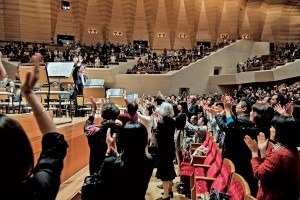 A standing ovation for the orchestra's final concert. Photographer: Jeremie Souteyrat for Bloomberg Pursuits