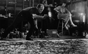 Jackson Pollock (1912-1956) at work Lee Krasner (his wife in the back)