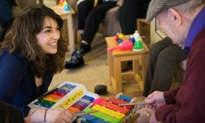Camerata musician Amina Cunningham works with dementia patients in Manchester. Photograph: Ciara Leeming for the Guardian