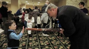 "PSO Principal Contrabassoon Jim Rodgers shows a young patron his bassoon before the February 2015 Fiddlesticks Family Series Concert, ""Winter Dreams."""