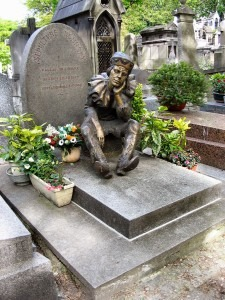 The Tomb of Nijinsky in Paris at the Montmartre Cemetary, with a statue of Nijinsky in the role of Petrushka
