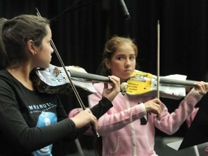 Members of the Recycled Orchestra of Paraguay with recycled instruments during a rehearsal at Vancouver College before their concert at UBC on Monday night, in Vancouver. NICK PROCAYLO / PNG