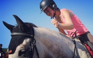 The HorseCom headphones in action CREDIT: HORSECOM