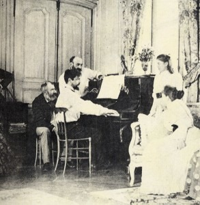 Chausson, standing, turning pages for Debussy (1893)
