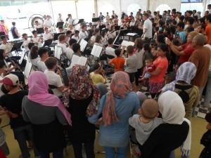 Neeta Yale CB Refugee Concert Wide Shot with Women