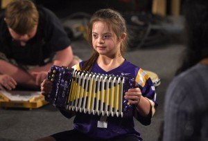 Mary Lynn Crow squeezes a note out of an accordion at the amplifi class. Advocate Staff Photo by Patrick Dennis