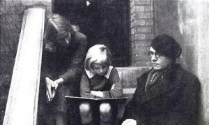Olivier Messiaen wearing a beret , sitting on the steps leading to his Parisian House ( 19th arrondissement ) , with his first wife Claire Delbos and son
