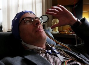 Neurologist and musician Thomas Deuel, wearing a wired-up electrode cap, is working at the UW to research brain activity in musicians and is further developing the encephalophone for people with limited motor ability so they can play by thinking. There's a patent pending on the process. (Alan Berner/The Seattle Times)