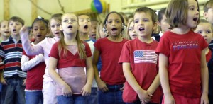Butner Elementary School students sing patriotic music on Fort Bragg, North Carolina. April 2, 2009. Jessica M. Kuhn / U.S. Army, CC BY