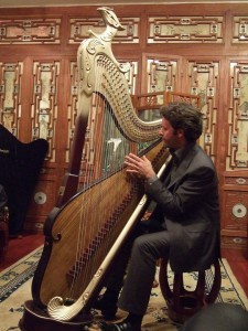 Jakez François is thrilled to try out a Konghou, one of his favorite harps.