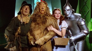 Scarecrow (Ray Bolger), the Cowardly Lion (Bert Lahr), Dorothy (Judy Garland), and the Tin Man (Jack Haley) in The Wizard of Oz