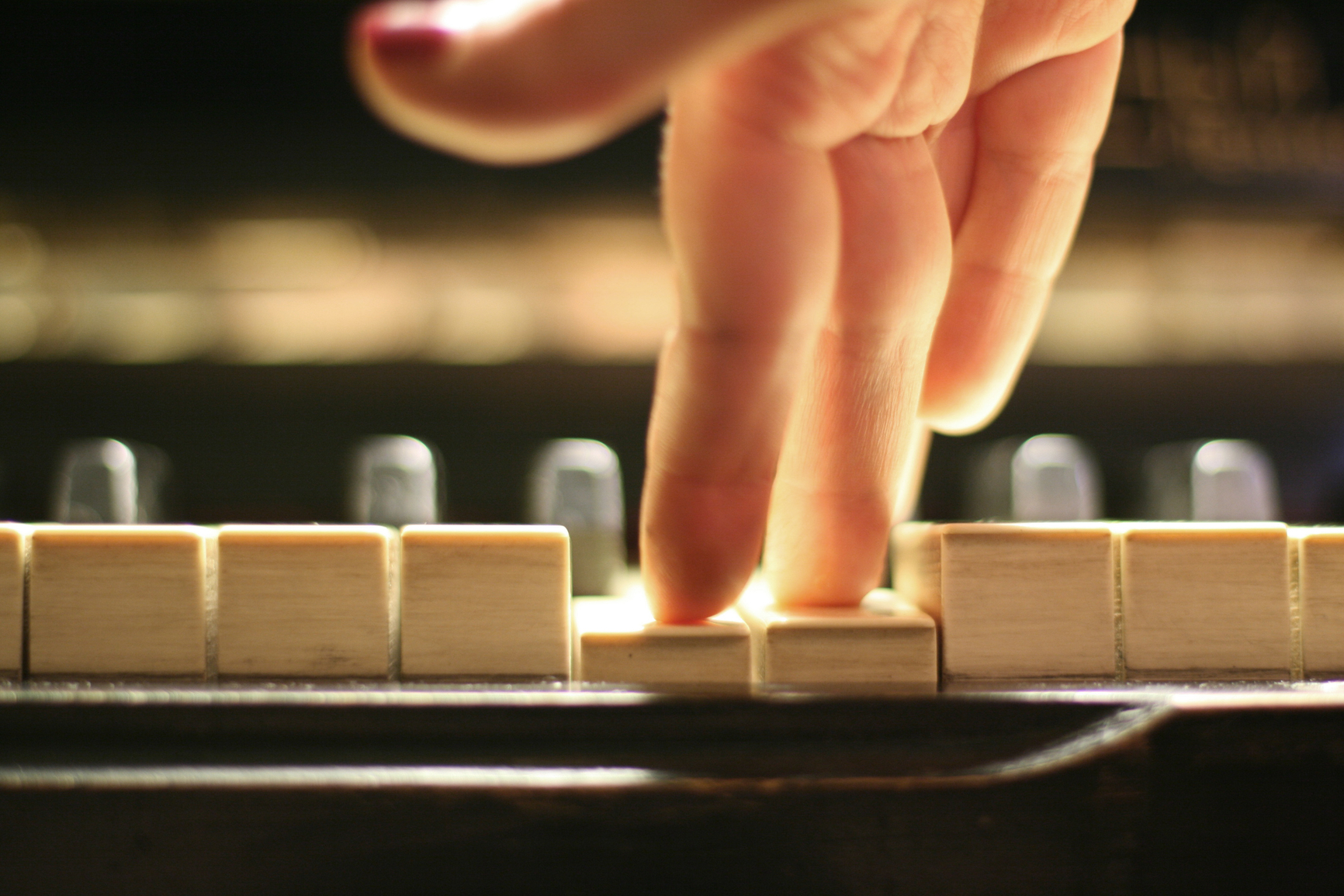 Finger on piano