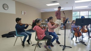 Refugee children practice at Orchestra Rouh, a program meant to help them feel part of a community. COURTESY PHOTO