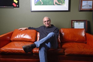 Bob Duke in his office seated on the burnt orange leather couch that was given to him by legendary Longhorn Band director Vincent DiNino. Photo by Marsha Miller.