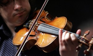 """Violinist Adrian Pintea, from The Julliard School, plays a 1729 Stradivari known as the """"Solomon, Ex-Lambert"""" in 2007 at Christie's in New York. Don Emmert/AFP/Getty Images"""