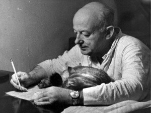 Henry Cowell composing with helping cat
