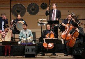 Yo-Yo Ma, the third cellist from right, and other members of the Silk Road Ensemble, at Carnegie Hall in 2013. Credit Hiroyuki Ito for The New York Times