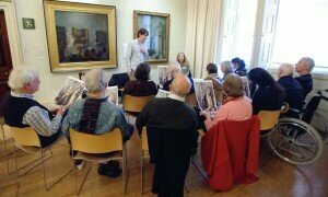 People living with dementia discuss art at a Royal Academy InMind session. Photograph: Roy Matthews