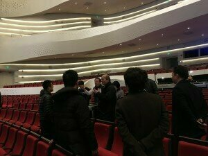 Composer Guan Xia talking to production team