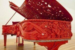He Korero Purakau mo Te Awanui o Te Motu: story of a New Zealand river, 2011 by Michael Parekowhai. Piano, wood, ivory, brass, lacquer, steel, ebony, paua shell, mother-of-pearl, upholstery. Te Papa Tongarewa, Wellington, NZ.