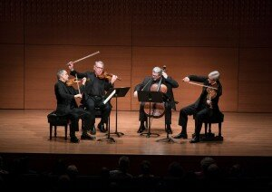 A solo during a quartet often forces a violist to awkwardly contort his or her body, as here with Lawrence Dutton, right, and the Emerson String Quartet.CreditCreditRichard Termine for The New York Times
