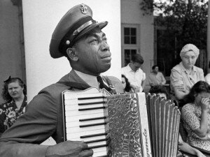 """U.S. Navy CPO Graham Jackson, with tears of grief, plays """"Goin' Home,"""" from Dvorak's 'New World' Symphony, as President Franklin D. Roosevelt's body is carried from Warm Springs, Ga., where he died.© Ed Clark/Life Picture Collection/Getty"""