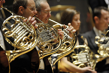 Brass players have to hold heavy instruments in awkward positions for long periods of time.