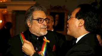 Leon Fleisher is greeted by Yo Yo Ma after receiving the Kennedy Center honors AP Photo/Jose Luis Magana