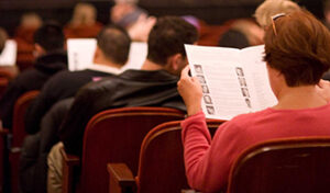 Concert audience reading program notes