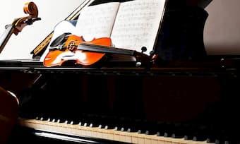 Piano, violin, and cello with scores