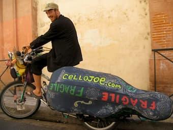 CelloJoe is the world's first long distance musical bike touring cellist!