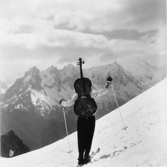 Cellos in alpine settings are reflected in this iconic photo taken by Robert Doisneau of renowned cellist Maurice Baquet, circa 1940.