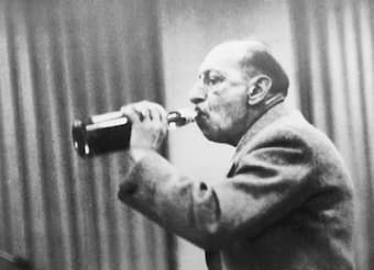 Igor Stravinsky drinking whiskey straight from the bottle
