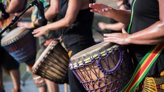 Musicians play on African drums